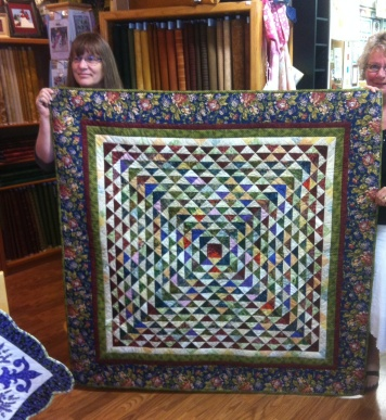"Elinor Martin-Law created ""Friendship Triangles"" By Laundry Basket Quilts by author Edyta Sitlar.  The picture does not do this justice! Elinor quilted this on her Handi Quilter Sweet 16"
