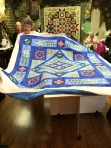 Dana Hagel with 'Imaginary Day' by Smith Street Designs, this quilt was done in Donna Morton's class